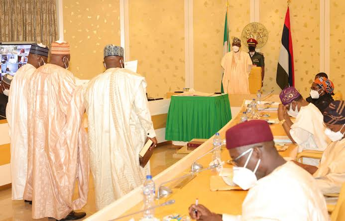 BREAKING: President Buhari swears in three [3] new INEC National  Commissioners » Crime Channels
